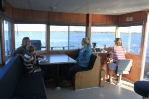 8 Sleeper Houseboat Family enjoying the view